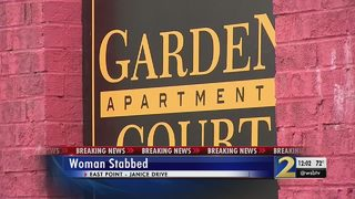 Police investigating after woman found stabbed to death behind dumpster