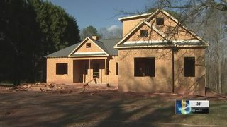 Men rob builders at gunpoint in garage of home under construction
