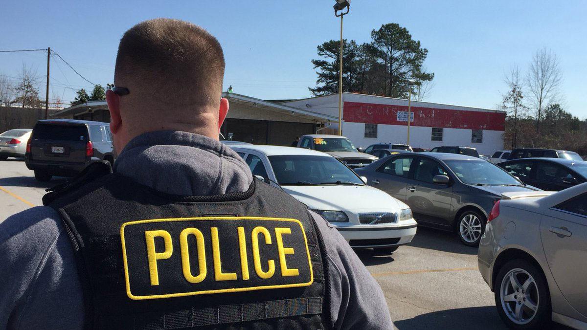 State agents raid car dealerships accused of printing fake