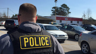 State agents raid car dealerships accused of printing fake dealer tags