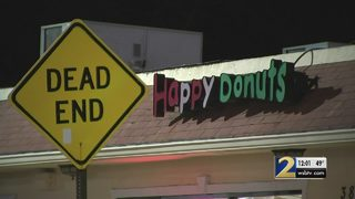 Police search for masked gunman who robbed local doughnut shop