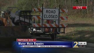 Large water main break leaves road closed in Norcross