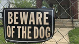 Beware of the dog sign.