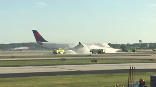 Smoke from engine causes plane to turn around at Atlanta airport