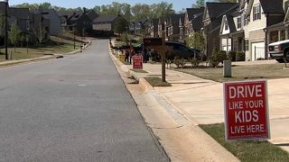 HOA pushing back against signs telling drivers to slow down, neighbors say