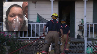Firefighters save woman from burning home
