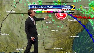 Cloudy, breezy with scattered showers early Tuesday evening