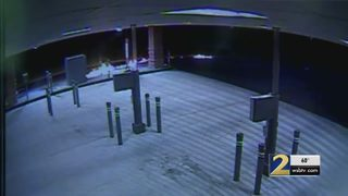 Surveillance video shows masked suspects burning ATMs
