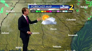 Breezy, with a mix of sun and clouds early Wednesday evening