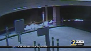 Police search for vandals who lit ATM on fire