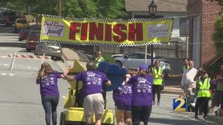 Bed race through city square raises money for homeless families