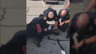 Officer fired over video showing him choking former NFL player during arrest