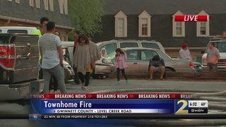 Dog alerts family to burning townhouse
