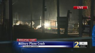 Investigators work into night after military plane crashes, killing 9
