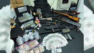 Investigators: Raid nets 8 military-style weapons,