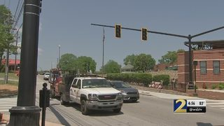 Busy Woodstock intersection gets lights, crosswalk signals 8 months after deadly accident