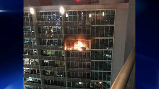 Fire at high-rise forces people who live there to evacuate