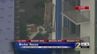 Window washer safe after platform collapses high above midtown
