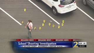 Investigators working to learn what led to shooting in elementary school parking lot