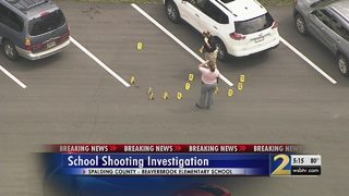 Police investigating shooting in elementary school parking lot