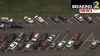 Shots fired in elementary school parking lot; Authorities working crime scene