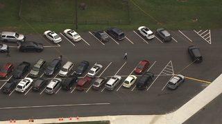 Shots fired in elementary school parking lot; Authorities working crime scene