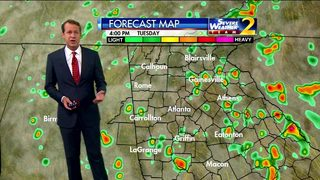 Cloudy skies with scattered showers early Tuesday evening