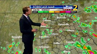 Clouds, scattered showers develop early Thursday evening