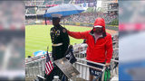 Photo of Braves fan holding umbrella over JROTC member in the rain goes viral