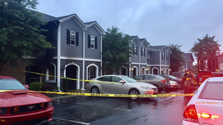 Woman dies after fire rips through town home; 2 others escape