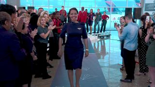 Delta debuts designer uniforms in new colors, high-tech material