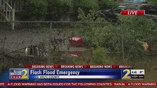 Woman describes watching flood water rise in her yard