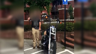 Video of motorcyclist parked in handicapped-accessible area sparks outrage