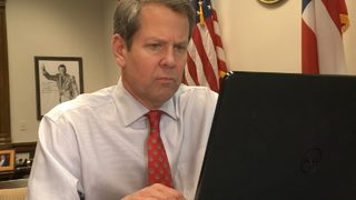 Investment company sues Brian Kemp over $500K loan