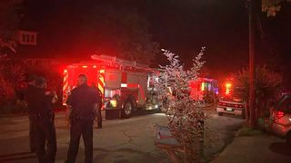 Woman rescued from burning home, man rushed to hospital