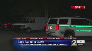 Police investigate body found face-down in creek