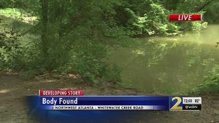 Authorities working to ID man found dead in creek