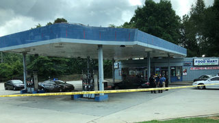 Innocent bystander killed in shootout at gas station, police say
