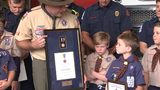 Child honored for saving his mother's life