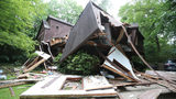 Gas company investigating house explosion that seriously injured 2 men