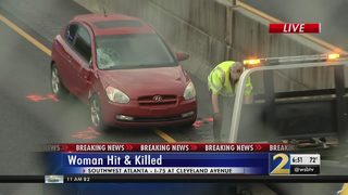 Woman dies after running into traffic on I-75, police say