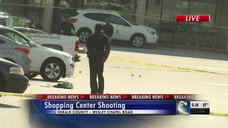3 people shot in grocery store parking lot, 1 detained, police say