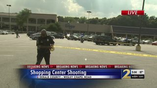 Multiple people shot in grocery store parking lot, police say