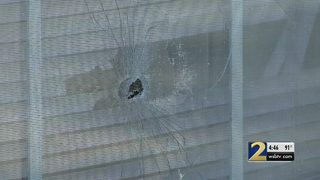 Shooter fires over a dozen bullets into apartment, police say