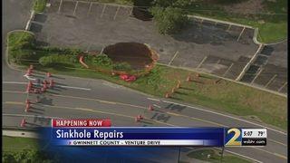 2 large sinkholes shut down road near busy cut-through