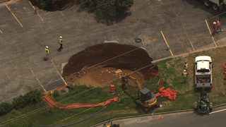 2 large sinkholes shut down busy cut-through, frustrate drivers