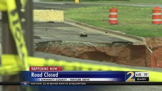 Crews work for 2nd day to fill 2 large sinkholes