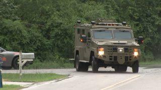Police: SWAT team arrests man after he shoots mother, fires at police
