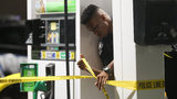 DeKalb and Gwinnett County police investigating at a BP gas station in Stone Mountain.