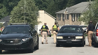 GBI investigating after police shoot at driver who pinned officer with her car